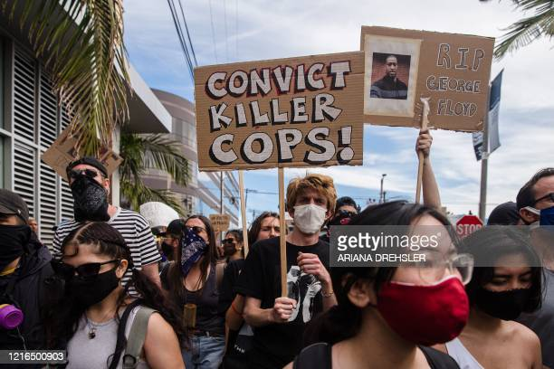 TOPSHOT Demonstrators march to protest against the death of George Floyd an unarmed black man who died while while being arrested and pinned to the...
