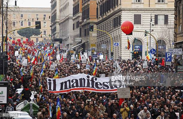 Demonstrators march to show their support for the Italian journalist Giuliana Sgrenam during a demonstration on February 19 2005 in Rome Italy...
