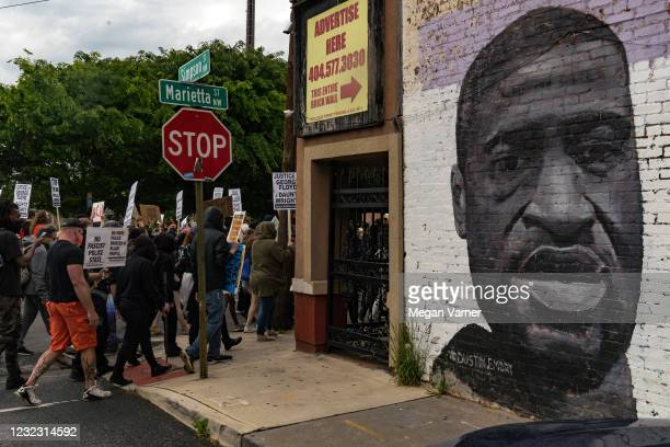 Demonstrators march to the National Center for Civil and Human Rights while protesting the shooting death of Daunte Wright on April 14, 2021 in...