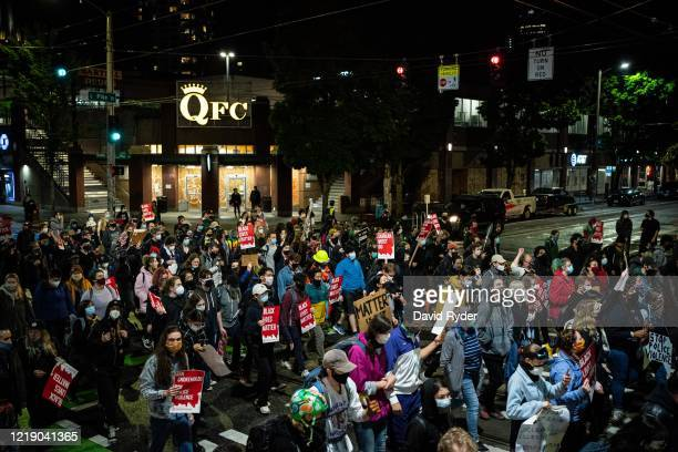 Demonstrators march to the Seattle Police Departments East Precinct after marching inside Seattle City Hall, led by Seattle City Council member...