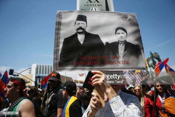 Demonstrators march towards the Turkish Consulate during a march and rally commemorating the 103rd anniversary of the Armenian genocide on April 24...