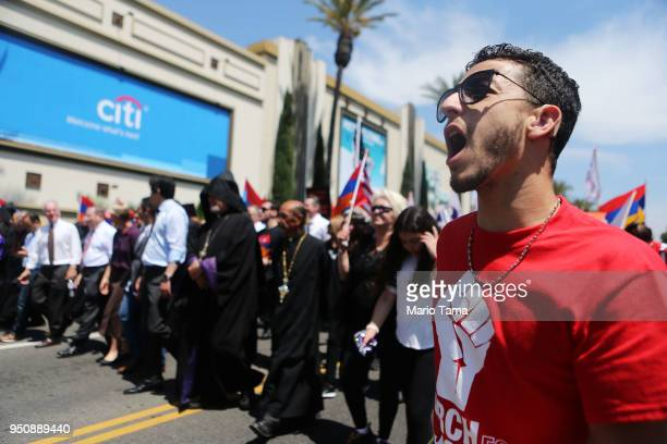 Demonstrators march towards the Turkish Consulate during a rally commemorating the 103rd anniversary of the Armenian genocide on April 24 2018 in Los...