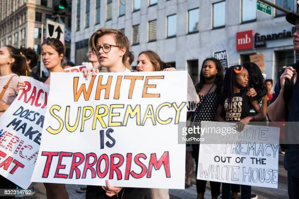 Demonstrators march towards Trump International Hotel and Tower Chicago in solidarity with the victims of the recent racist violence in...