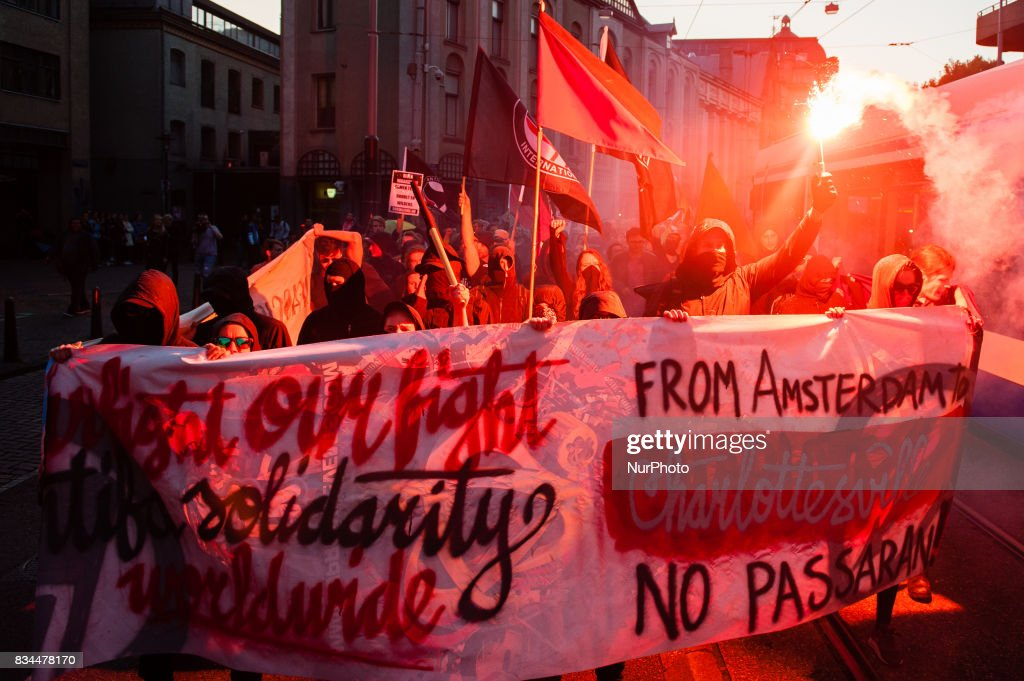 Demonstrators march with a banner during a protest called by the Dutch Antifascist Action AFA (Anti Fascistische Actie) against the violence that took place at the August 12th 'Unite the Right' rally in Charlottesville, at Spui Square in Amsterdam, Netherlands on August 17, 2017. Last Saturday, a neo-nazi drove his car into an anti-fascist protest against one of the biggest nazi demonstrations in the USA, which took place on the same day. This resulted in multiple serious injuries and the death of 32 year old Heather Heyer. With this demonstration that was organized by AFA Nederland, people in The Netherlands wanted to show their support to all the anti-fascist victims and with the relatives of Heather Heyer. The demonstration passed in front of the American embassy situated in the Museumplein, Amsterdam.