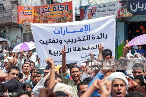 Demonstrators march with a sign reading in Arabic the UAE is the leader of destruction and fragmenting the Arab region during a protest in the...