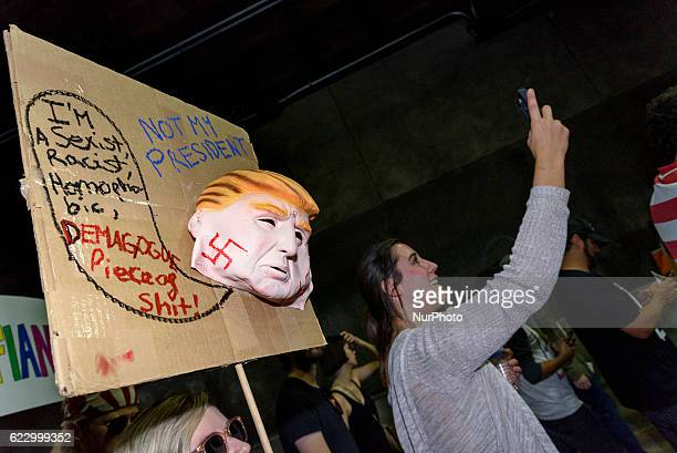 Demonstrators marched through the streets of Los Angeles in protest of PresidentElect Donald Trump Los Angeles California November 12 2016 According...