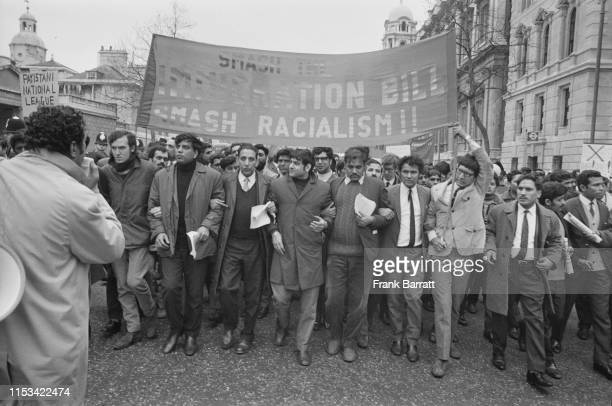 Demonstrators marching down Whitehall to protest against the British Government's new immigration bill London 21st March 1971 Second from left is...