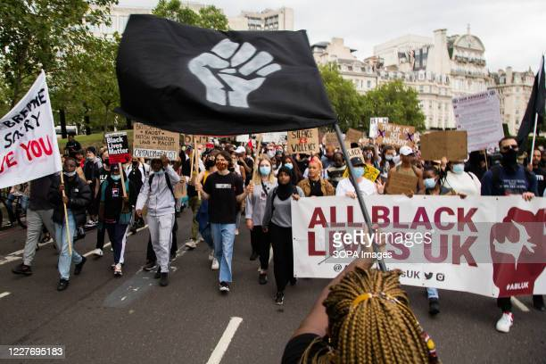 Demonstrators marching with banners flags and placards during a Black lives Matter protest in central London Londoners are still marching for racial...