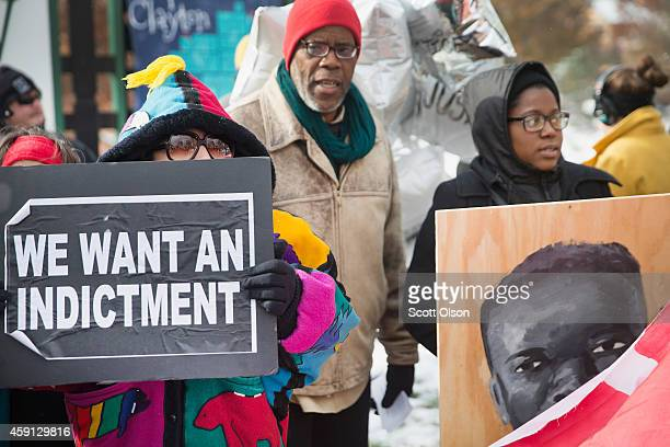 Demonstrators mark with a protest the 101st day since 18yearold Michael Brown was killed on November 17 2014 in Clayton Missouri Brown was killed by...