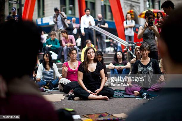 Demonstrators meditate at Zuccotti Park where hundreds of protestors have camped out in Lower Manhattan for 12 days on Wednesday, September 28, 2011....