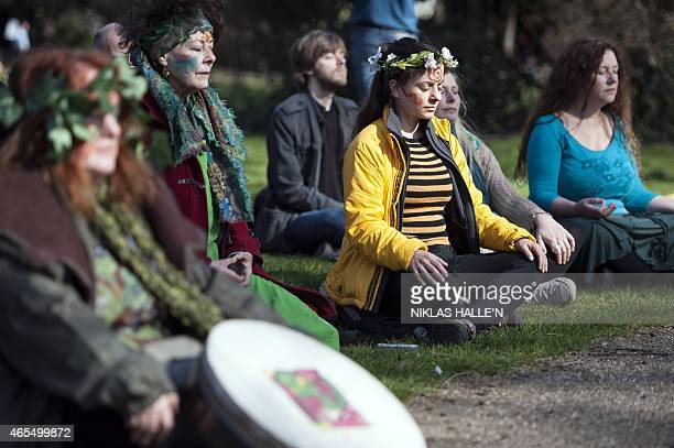Demonstrators meditate before taking part in The People's Climate march in central London on March 7, 2015. Around 5,000 protesters marched on the...