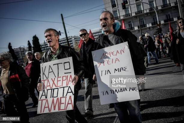 Demonstrators members of the Greek Communist Party shout slogans during the demonstration and the 24 hour strike while holding banners Athens...