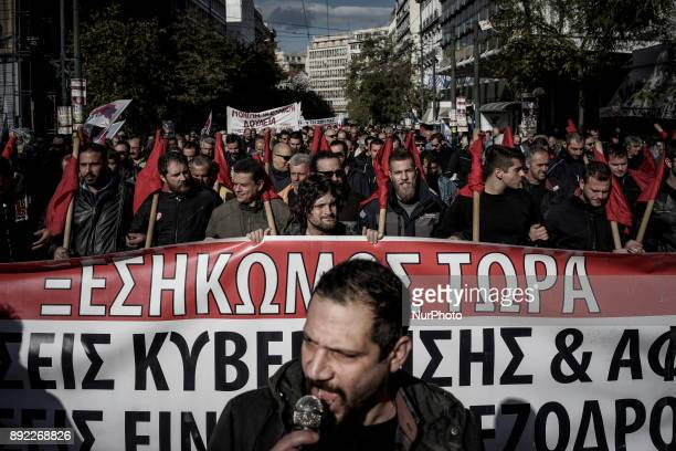Demonstrators members of the Greek Communist Party shout slogans during the demonstration and the 24 hour strike Athens December 14 2017