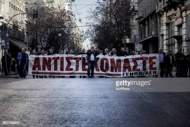 Demonstrators members of the Private Sector Union shout slogans and hold a banner during the demonstration and the 24 hour strike Athens December 14...