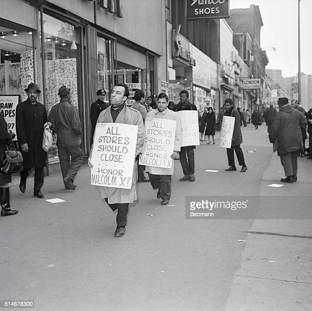 Demonstrators mourning the death of Malcolm X picket a store in Harlem that refused to join a closure to honor the slain leader