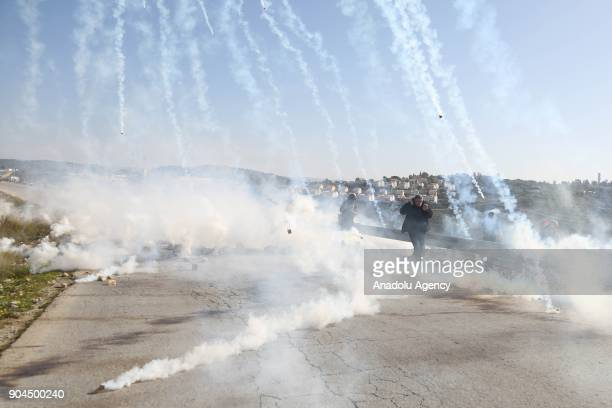Demonstrators move away after Israeli security forces' intervention during a protest against US decision to recognize Jerusalem as Israel's capital...