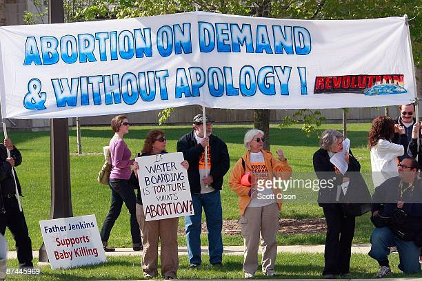 Demonstrators of both sides of the abortion debate compete for attention near the campus of Notre Dame University on May 17, 2009 in South Bend,...