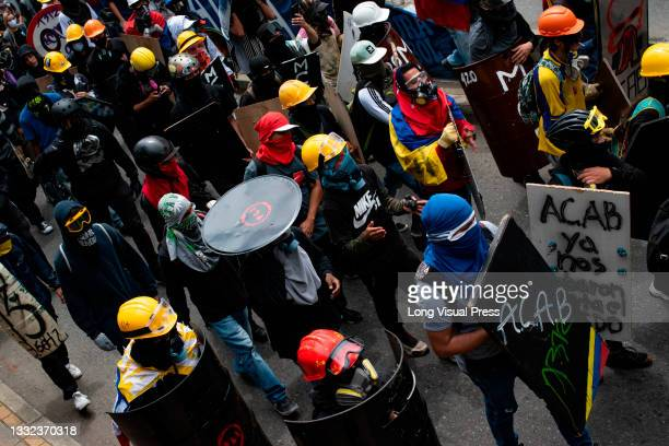 Demonstrators of the front line using construction helmets and crafted shields as demonstrations ended in late-night clashes between riot police and...
