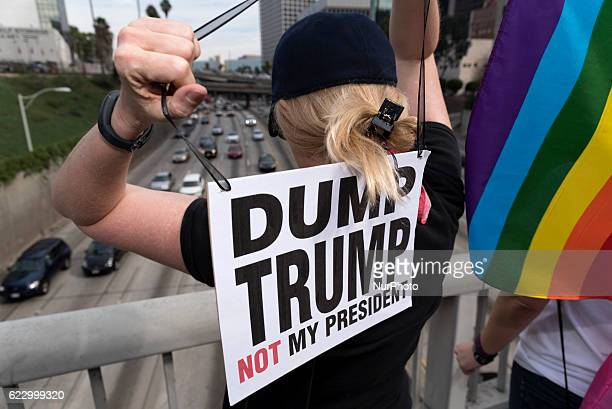 Demonstrators on a freeway overpass during an antiTrump protest in Los Angeles California on November 12 2016 According to the LAPD an estimated...