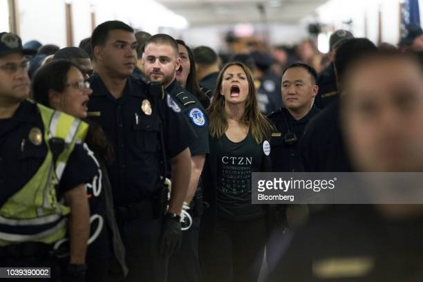A demonstrator opposed to the Supreme Court nominee Brett Kavanaugh is detained by US Capitol police near the office of Senator Susan Collins a...