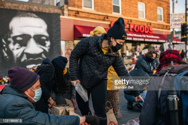 Demonstrators organize candles ahead of a candlelight vigil on March 28, 2021 in Minneapolis, Minnesota. Community members continue demonstrations...