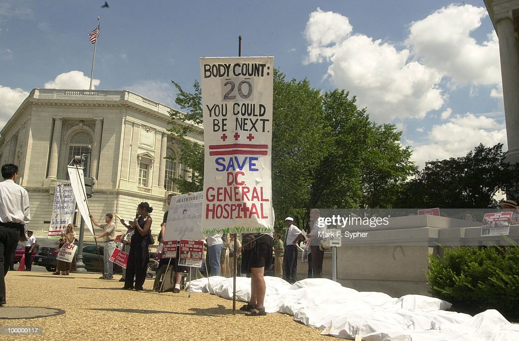 Demonstrators outside of the Longworth building Thursday afternoon who are part of the D.C. Coalition to Save D.C. General Hospital layed out 20 'body bags' on the sidewalk, symbolizing lives which may have been saved if D.C. General had been admitting patients.