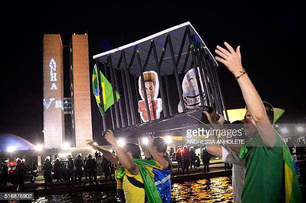 Demonstrators outside the National Congress protest against the administration of President Dilma Rousseff and in support of Judge Sergio Moro who is...