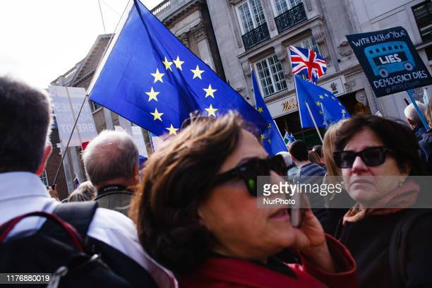 Demonstrators pack St James's Street during the mass 'Together for the Final Say' march organised by the 'People's Vote' campaign for a second Brexit...