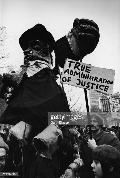 Demonstrators parade through City Hall Plaza carrying effigies and other items New York New York February 16 1970 The protest was related to events...