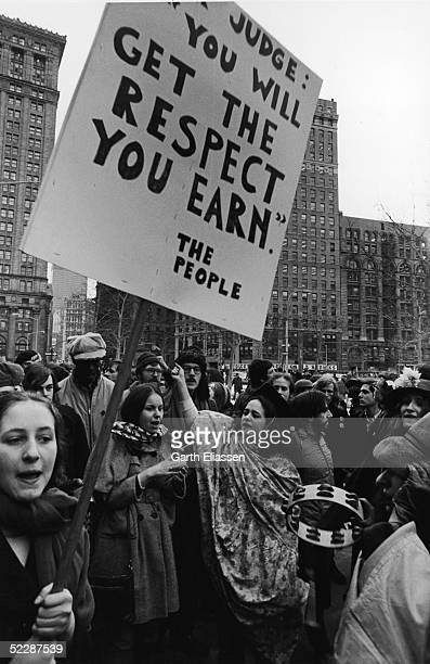 Demonstrators parade through City Hall Plaza carrying sign tambourines and other items New York New York February 16 1970 The protest was related to...