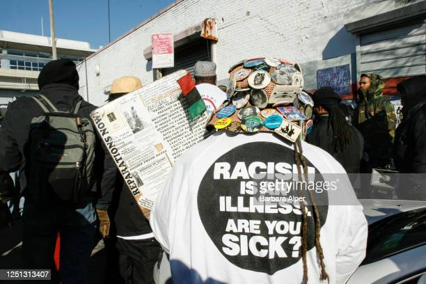 Demonstrators participate in a march against police brutality in the Jamaica neighborhood of Queens New York New York December 9 2006 One person...