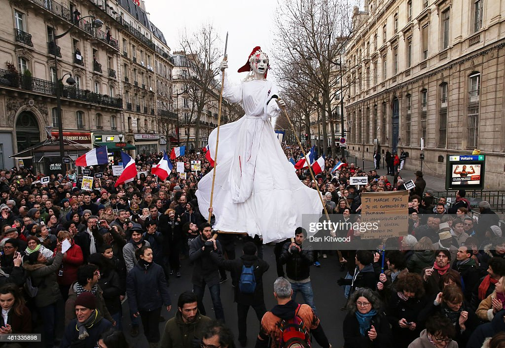 Demonstrators participate in a mass unity rally following the recent Paris terrorist attacks on January 11, 2015 in Paris, France. An estimated one million people have converged in central Paris for the Unity March joining in solidarity with the 17 victims of this week's terrorist attacks in the country. French President Francois Hollande led the march and was joined by world leaders in a sign of unity. The terrorist atrocities started on Wednesday with the attack on the French satirical magazine Charlie Hebdo, killing 12, and ended on Friday with sieges at a printing company in Dammartin en Goele and a Kosher supermarket in Paris with four hostages and three suspects being killed. A fourth suspect, Hayat Boumeddiene, 26, escaped and is wanted in connection with the murder of a policewoman.