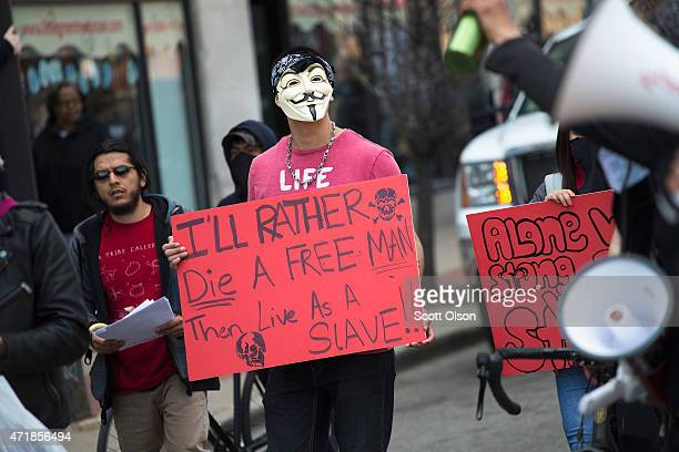 Demonstrators participate in a May Day march on May 1 2015 in Chicago Illinois The demonstration was one of many around the world on what has become...