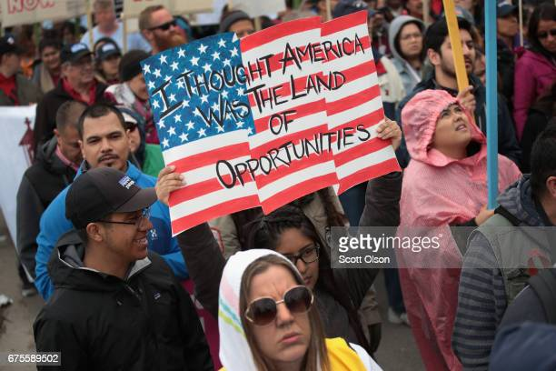 Demonstrators participate in a May Day rally in Union Park before marching to downtown on May 1 2017 in Chicago Illinois May Day also known as...