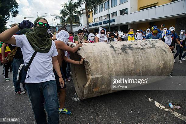 Demonstrators participate in a protest against the government of Venezuelan President Nicolas Maduro in Caracas VenezuelaThe Venezuelan government...