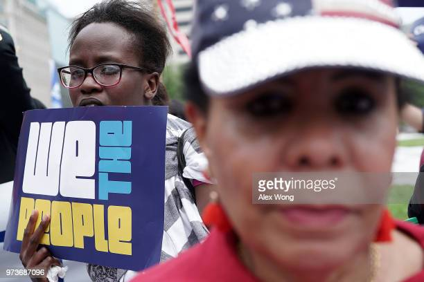 Demonstrators participate in a protest June 13 2018 in Washington DC Democratic congressional members joined actives to protest 'the Trump...
