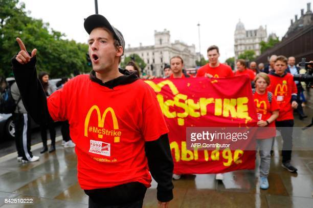 Demonstrators participate in a protest over working conditions and the use of zerohour contracts at British outlets of US burger chain McDonalds in...