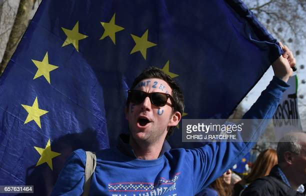 Demonstrators participate in an anti Brexit proEuropean Union march in London on March 25 ahead of the British government's planned triggering of...