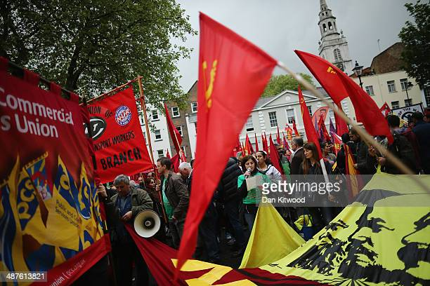 Demonstrators participate in the annual May Day march to Trafalgar Square on May 1 2013 in London England Thousands attended the traditional May Day...