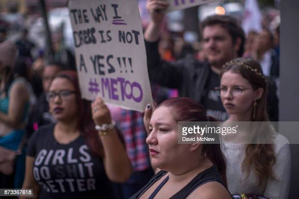 Demonstrators participate in the #MeToo Survivors' March outside the CNN building in response to several highprofile sexual harassment scandals on...