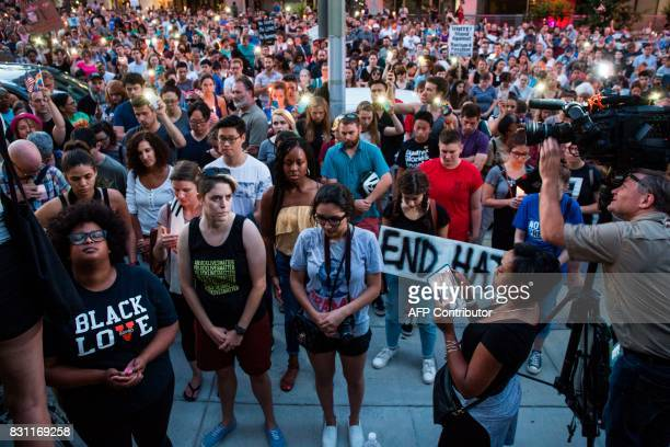 Demonstrators pause for a moment of silence in front of the statue of Confederate General Albert Pike on August 13 2017 in Washington DC the only...