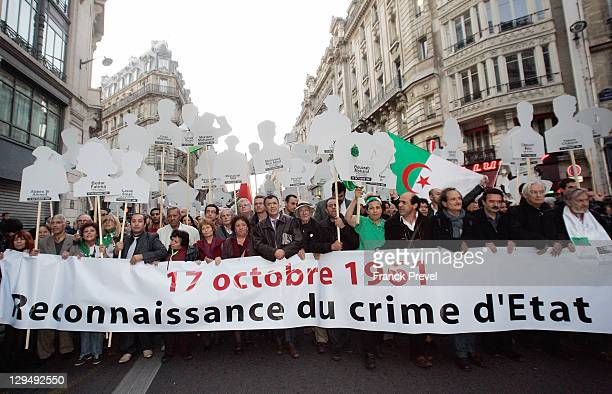 Demonstrators pay their respects to the dead Algerians who were killed during the massacre in 1961 with a banner who reads Recognition of the crime...