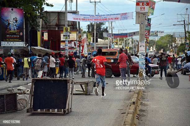 Demonstrators place barricades in PortauPrince on November 29 2015 during a protest against the results given by the Provisional Electoral Council...