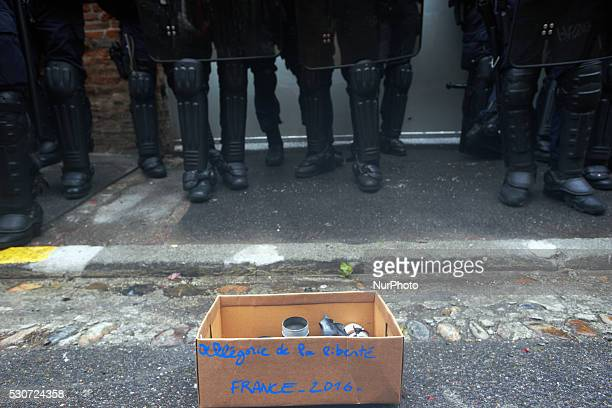Demonstrators placed a box with discarded teargas canisters in front of riot police who stand guard the bureau of the Socialist Party in toulouse It...