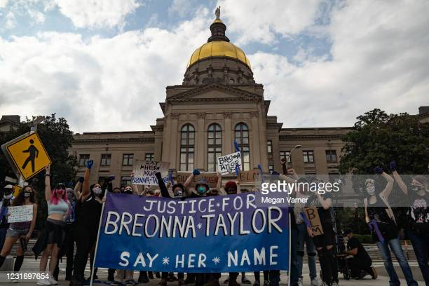 Demonstrators pose for a picture in front of the Georgia Capitol building while marching through down town in honor of Breonna Taylor on March 13,...