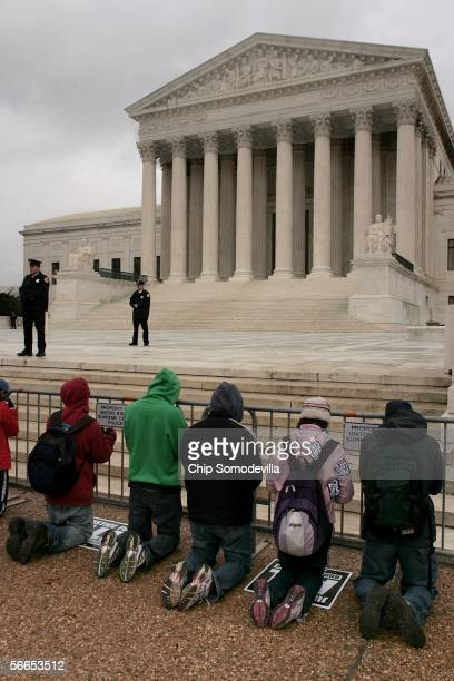 Demonstrators pray in front of the Supreme Court during the March for Life to mark the 33rd anniversary of the landmark Supreme Court case Roe v Wade...