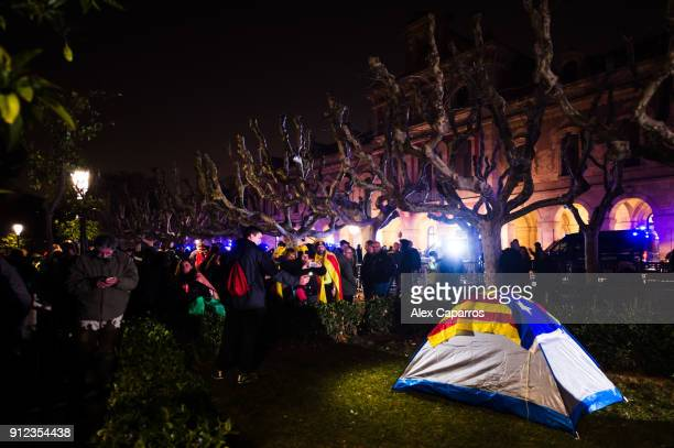 Demonstrators prepare to camp during a protest to support former Catalan President Carles Puigdemont in front of the Parliament of Catalonia on...