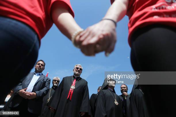 Demonstrators prepare to march towards the Turkish Consulate during a rally commemorating the 103rd anniversary of the Armenian genocide on April 24...