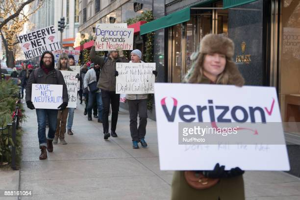 Demonstrators protest a plan by the Federal Communications Commission to repeal net neutrality outside a Verizon store on December 7 2017 in Chicago...