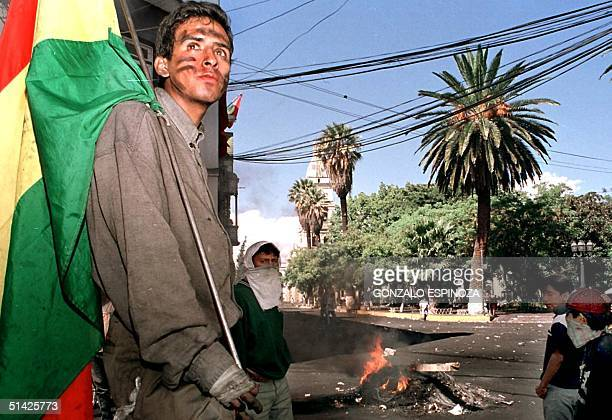 Demonstrators protest a proposed hike in water rates 10 April 2000 in Cochabamba, Bolivia. An end to a week of violent protests in Bolivia appeared...